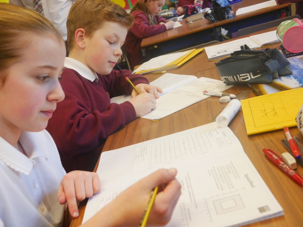 Year 6 working at desks (3)a