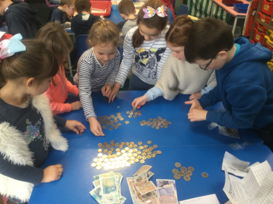 The children are enjoying sorting and counting lots of money today.